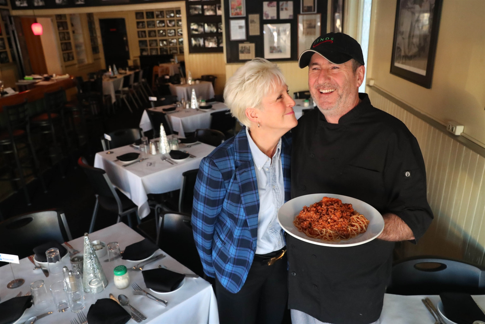 Vino's owners Kathleen and Tony Cangianiello present the spaghetti Bolognese.